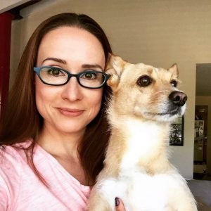 Author Camela Thompson and her dog Annie, President of the Arch nemesis obliteration Coalition.